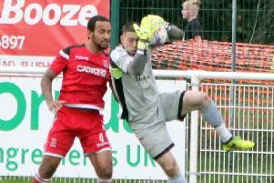 Barnoldswick Town goalkeeper Ryan Livesey saves from Leon Ashman