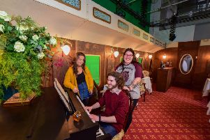 From left, students Hope Harvey, Joe Littler and Chloe Smith onboard The Northern School of Art's Hartlepool to Istanbul full-scale luxury period train carriage set at No 1 Church Street, Hartlepool.