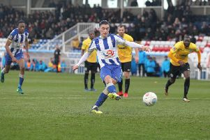 Josh Hawkes slots in the second of his penalties for Pools.