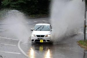 Wet and windy conditions are causing problems for motorists across Lancashire this morning.