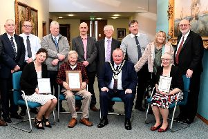 The Mayor of Hartlepool Councillor Alan Barclay with (sitting left to right) Lisa Barwick, Drew Mills and Karen Milner after he presented them with their certificates, with invited guests standing.