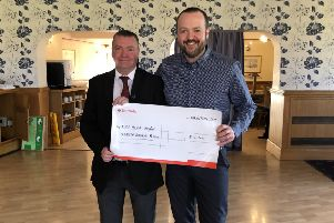 Hartlepool Golf Club 2018-19 captain Neil Ashby (left) hands over a cheque for �17,000 to Greg Hildreth of Alice House Hospice.