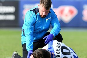 Aaron Cunningham receives treatment after suffering a knee injury.