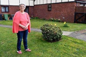 Patricia Brown from The Sycamores next to the spot where her washing pole was removed by the residents association. Picture by FRANK REID