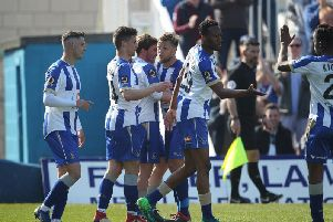 Pools' players celebrate Luke James' equaliser (Shutterpress).