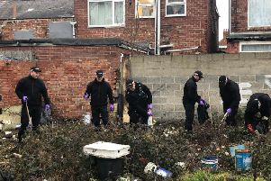 Officers involved in a Cleveland Police search operation.
