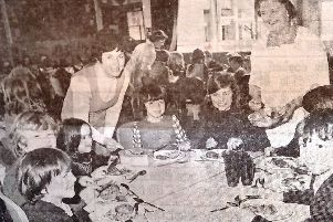 Children at West Park Junior and Infants School tuck into a tasty meal in 1975.