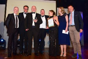 Best Small Business Award winner Cipher Medical receive the trophy from Hartlepool Council leader Christopher Akers-Belcher (left) and Chris Soley, director and general manager at Camerons Brewery (right).