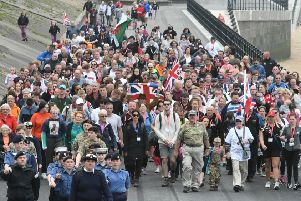 End of 16-mile sponsored walk from Tommy statue in Seaham to Hartlepool's Heugh Battery Museum which aimed to raise money for gun battery museum.