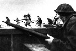 Canadian soldiers land on Courseulles beach in Normandy, 06 June 1944 as Allied forces storm the Normandy beaches on D-Day. D-Day, 06 June 1944 is still one of the world's most gut-wrenching and consequential battles, as the Allied landing in Normandy led to the liberation of France which marked the turning point in the Western theater of World War II. Photo credit: AFP/Getty Images.