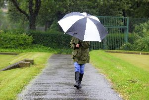 This walker had to resort to using a brolly during Wednesday morning's downpour.
