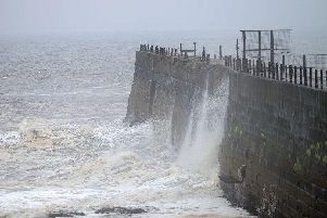Incoming tidal waves hitting the Headland Pier during a spell of wet and windy weather in and around Hartlepool.