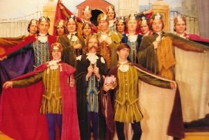A scene from 1988. The Brinkburn men's chorus in the production of Iolanthe.