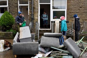 Residents begin clearing up following severe flooding. (Photo by Anthony Devlin/Getty Images)