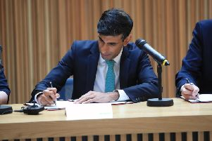 Chancellor Rishi Sunak signs the devolution deal in Leeds. Pic: PA