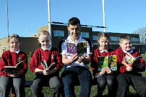 Author Tom Palmer reading one of his books with West View Primary school pupils (left to right) Katie Douglas, Rhys Blackwood, Katie Reid and Alex Griffin . Picture by FRANK REID