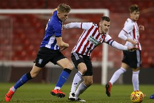 Jack Lee of Sheffield Wednesday tackles Paul Coutts of Sheffield Utd during the Professional Development League North match at Bramall Lane Stadium, Sheffield. James Wilson/Sportimage
