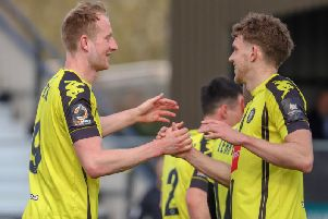 Mark Beck, left, is congratulated by Callum Howe after opening the scoring against Maidstone United. Picture: Matt Kirkham