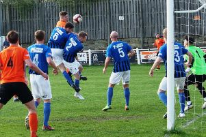 Brighouse Town v Cleethorpes'Reece Kendall  heads the ball