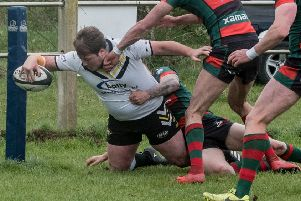 A Greetland All Rounders player goes over against Leeds Akkies