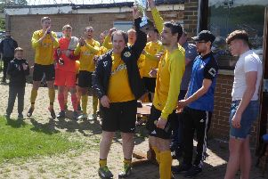 Waiters Arms manager Adam Fenton and captain Lee Wood lift the Mel Owens Invitational Trophy