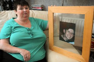 Beverley Keenan with a photograph of her late brother Wayne (known as Joey)