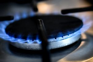 A gas ring on a home cooker.