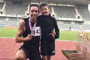 Dave Mendonca with son Diego and his British Masters gold medal in Birmingham