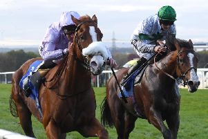 King Carney, ridden by Daniel Tudhope, (left) wins the ebfstallions.com Silver Tankard Stakes at Pontefract Racecourse. Picture: Anna Gowthorpe