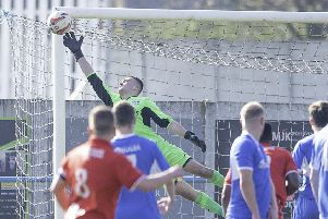 Jordan Greaves makes a save in last season's game between Hemsworth MW and Bridlington Town.