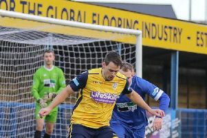 Nathan Hotte defends strongly for Frickley Athletic at Leek Town. Picture: Onion Bag Photos