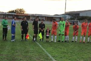 The teams line-up before kick-off