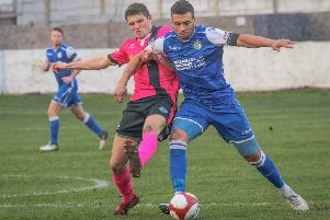 Ant Wilson holds the ball up for Frickley Athletic against Pickering Town. Picture: Onion Bag Photos