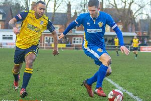 Frickley Athletic's Jacob Hazel closes down a Spalding United player. Picture: Onion Bag Photos