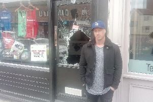 Muscleforce owner Neill Sly outside the sports nutrition shop on Northgate in Wakefield.