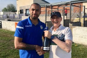 Jacob Hazel is presented with a bottle of bubbly to mark his 150th appearance for Frickley Athletic, during which time he has scored 98 goals. Making the presentation is press officer Michael Johnson.