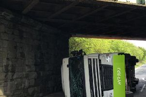 The van toppled over after trying to negotiate the low bridge. (Photo: @WYP_RPU)