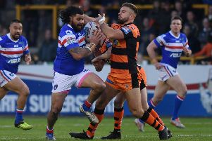 Wakefield Trinity's David Fifita is tackled by Castleford Tigers' Mike McMeeken in the previous meeting between the two rivals this season.
