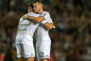 Kalvin Phillips commiserates with Jack Harrison after his missed penalty for Leeds United in their shoot-out against Stoke City. Picture: Bruce Rollinson