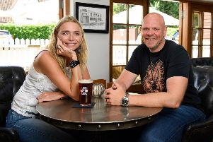 Publican and model, Jodie Kidd presents a personalised blue plaque to Tom Kerridge, commemorating her favourite pub memory, which took place at The Hand and Flowers in Marlow