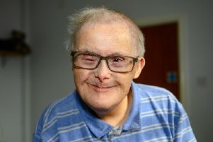 George Wildgust, whose family believe he is the oldest person in the UK with Down's syndrome, has said dancing keeps him young, after celebrating his 77th birthday.