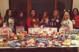 Hayley Kay and her friends donating food to needy families