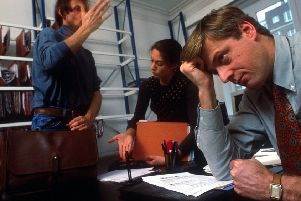 Stressed business people at work. Picture by Liaison/Getty.