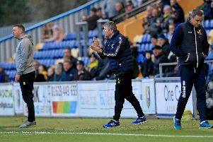 Stags bench urge their side on.