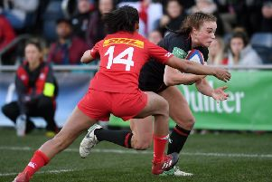 Going through: England's Kelly Smith gets away from Canada's Magali Harvey to score a try at Castle Park. Picture: Jonathan Gawthorpe