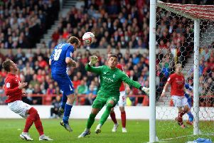 NOTTINGHAM, ENGLAND - MAY 04:  Andy King of Leicester City scores his sides second goal during the npower Championship match between Nottingham Forest and Leicester City at City Ground on May 4, 2013 in Nottingham, England.  (Photo by Laurence Griffiths/Getty Images)