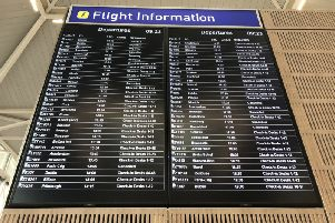 A departure board at Bristol Airport showing flybmi flights cancelled following the collapse of the airline. Photo: PA Wire