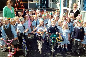 2007: Children prepare for a sponsored bike ride at Hucknall Holy Cross. Are you on this picture?