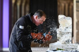 Mat Chaloner of Glacial Art, at work on a ice sculpture at Durham Cathedral