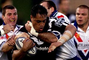 New Zealand's Joe Vagana is tackled by Great Britain's Iestyn Harris, Chris Joynt and Kieran Cunningham during the tri-series played at Ericsson Stadium, Auckland in 1999